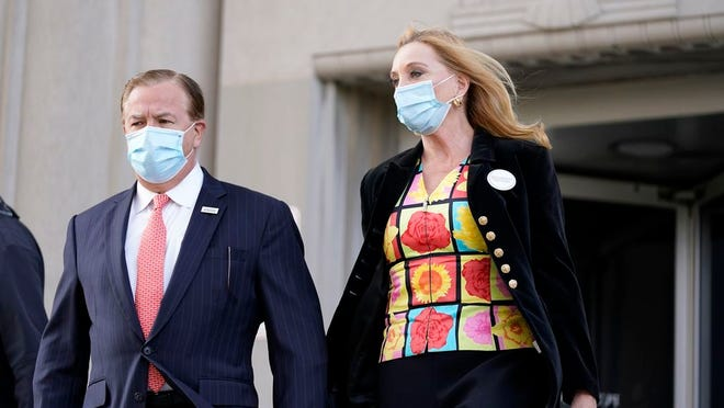 FILE - In this Oct. 14, 2020, file photo, Mark and Patricia McCloskey leave following a court hearing, in St. Louis.