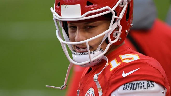Kansas City Chiefs quarterback Patrick Mahomes walks on the sideline during the second half of an NFL divisional round football game against the Cleveland Browns, Sunday, Jan. 17, 2021, in Kansas City.