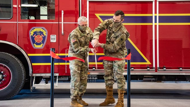 From left, Brig. Gen. James Bonner, MSCoE and Fort Leonard Wood commanding officer, and Col. Jeff Paine, Garrison commander, officially cut the ribbon on Fort Leonard Wood's Fire Station No. 3 Friday morning. The 17,000-square-foot, state-of-the-art facility located in Bldg. 2375 on Oklahoma Avenue will help firefighters on post meet certain time and distance response standards in the eastern parts of the cantonment area.