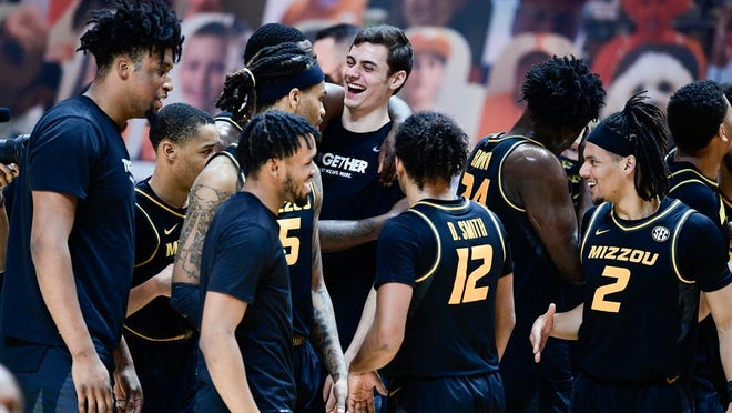 Missouri players react after defeating Tennessee in an NCAA college basketball game Saturday, Jan. 23, 2021, in Knoxville, Tenn.