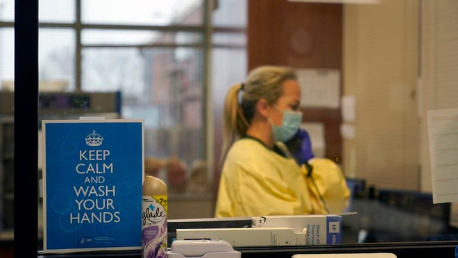 FILE - In this Nov. 24, 2020, file photo, registered nurse Chrissie Burkhiser works in the emergency room at Scotland County Hospital in Memphis, Mo.