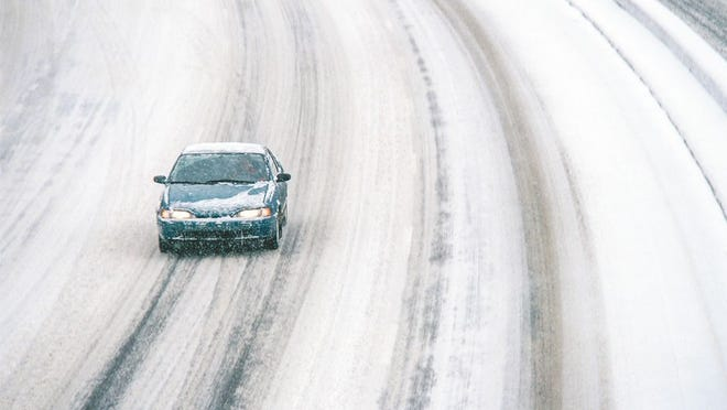 FILE - The Missouri Department of Transportation is urging motorists to use caution on snowy roads and avoid areas where blowing snow could lead to whiteout conditions.