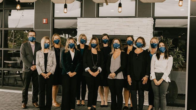 The team at Lakeshore Advantage poses for a photo amid the COVID-19 pandemic. The economic development organization held its annual investor meeting via Zoom on Friday, Jan. 29.