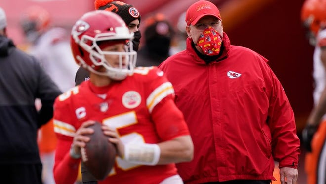 In this Sunday, Jan. 17, 2021 file photo, Kansas City Chiefs head coach Andy Reid, right, watches quarterback Patrick Mahomes warm up before an NFL divisional round football game against the Cleveland Browns in Kansas City.
