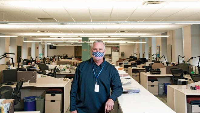 Security officer Phil Gilliland in the Dispatch Magazines Broad Street office
