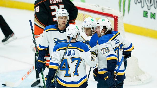 St. Louis Blues players react after a goal by center Brayden Schenn, second from right, during the second period of an NHL hockey game against the Anaheim Ducks, Sunday, Jan. 31, 2021, in Anaheim, Calif.