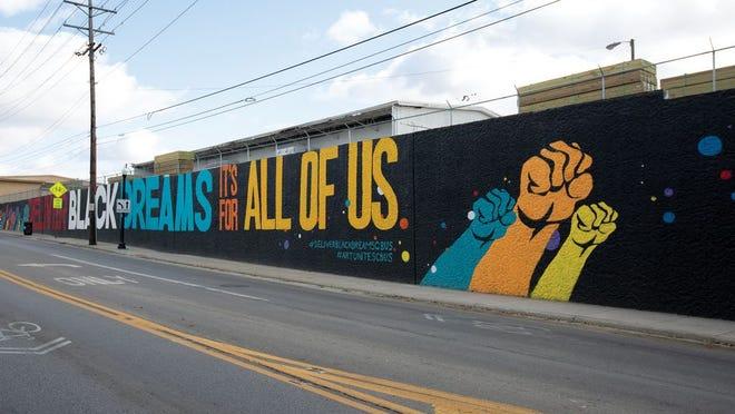 Deliver Black Dreams mural in Milo-Grogan