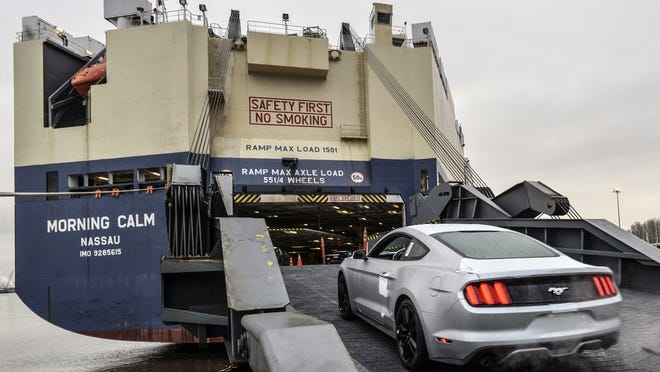 2015 Ford Mustang is loaded on a ship at the Port of Portland in Portland, Ore. The vessel will deliver all-new Mustangs to China and Korea.