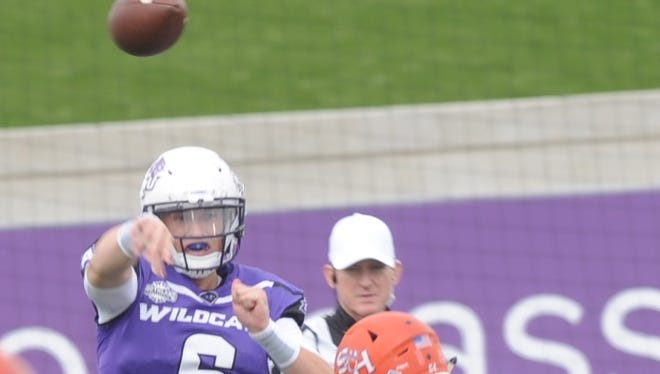 ACU quarterback Luke Anthony (6) throws the ball before being hit by Sam Houston State's Justin Johnson. The No. 4 Bearkats beat ACU 44-35 Saturday, Nov. 11, 2017 at Wildcat Stadium.