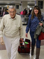 World War II veteran Frank Pontisso, 90, returns to Des Moines on Monday, March 23, 2015, after a commemorative trip to the island of Iwo Jima, where he fought as a Marine in 1945. His daughter, Lisa, met him at the airport.