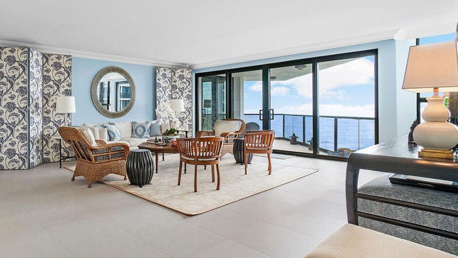 A bank of sliding glass doors affords wide views of the Atlantic in the living room of condominium 3-403 at 3120 S. Ocean Blvd. in Palm Beach. The three-bedroom unit is listed at $2.85 million.