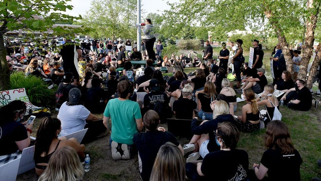"""More than 300 turned out for a """"Black Lives Matter"""" protest Wednesday night at the Pearl Albert Green Park at Secor and Sterns Rds. in Lambertville. Throughout the protest, many attendees took turns sharing words of solidarity using a megaphone, as is pictured."""