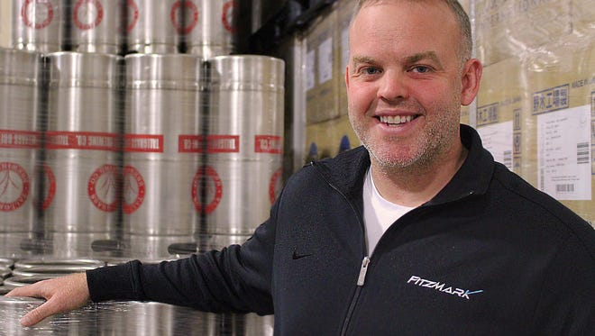 Scott Fitzgerald is president of FitzMark, a third-party logistics provider in Indianapolis. He is shown in the warehouse of Craftroads Beverage, a distribution company he co-founded.