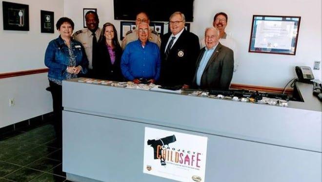Shelby County Sheriff' Office officials distribute free gun locks Tuesday at Arlington substation.