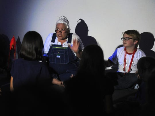 Bird Thomas is dressed as a character from one of Mark Teague's books during a reading at The Center for Contemporary Arts at the Children's Art & Literacy Festival in 2016.