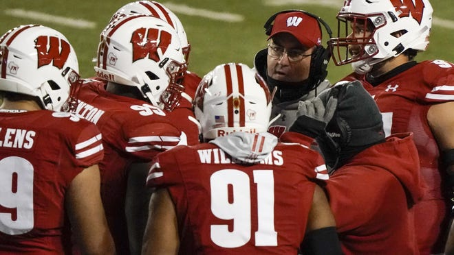 Wisconsin head coach Paul Chryst talks to his players on Friday, Oct. 23 in Madison, Wis. Wisconsin's game Saturday against Purdue is canceled because of a COVID-19 postiive tests.
