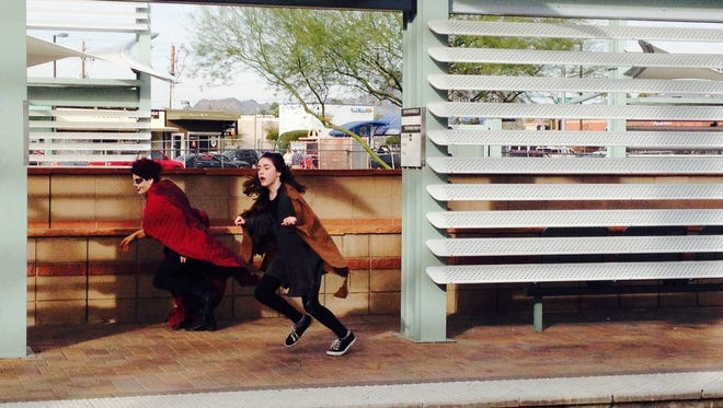 """Maeve Woodson (left) and Osiris Cuen perform in 2015's """"Light Rail Plays"""" at Camelback Road and Central Avenue."""