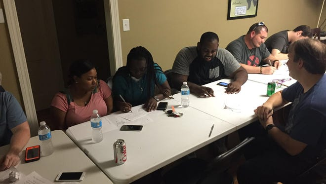 A group of people gathered Monday at The Spectrum Center to write letters to state and federal lawmakers urging better laws to protect people of color from undue police brutality.
