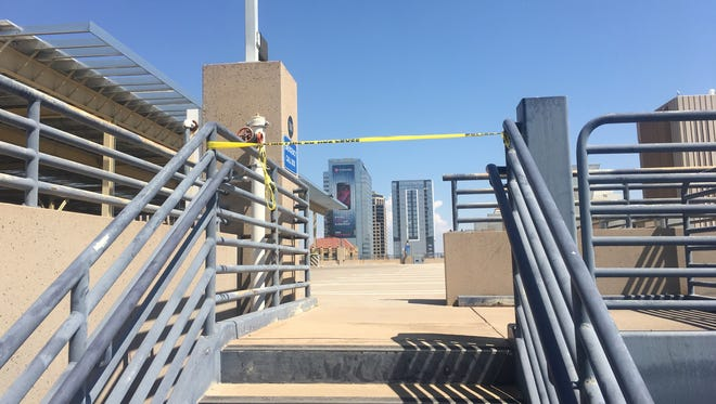 Phoenix police said a man jumped off the roof of a parking structure on Jefferson Street in downtown Phoenix on Sept. 12, 2017.