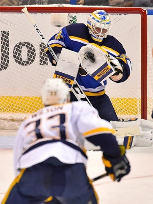 Blues goalie Jake Allen (34) makes a save against the Predators during the second period at Scottrade Center.