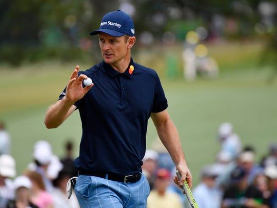 Justin Rose reacts to fans after putting on the seventh green during the second round of The Masters.
