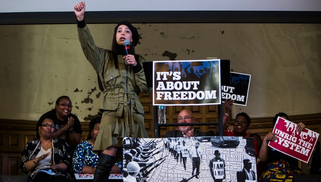 "February 24, 2018 - Angela Rye, CNN liberal political commentator and an NPR political analyst, salutes with a Black Power fist at the conclusion of her speech during the Working People's Day of Action union rally at Clayborn Temple on Saturday afternoon. According to www.itsaboutfreedom.org, the event ""is about demanding an end to the rigged economy and defending our freedoms."" The event called for ""working people to come together and fight for decent and equitable pay for our work, affordable health care, quality schools, vibrant communities and a secure future for all of us."""