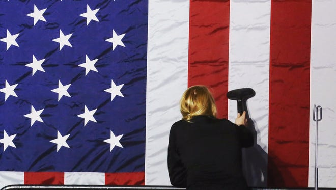 A campaign worker steams wrinkles out of an American flag before a  primary party for Hillary Clinton in Manhattan in April.