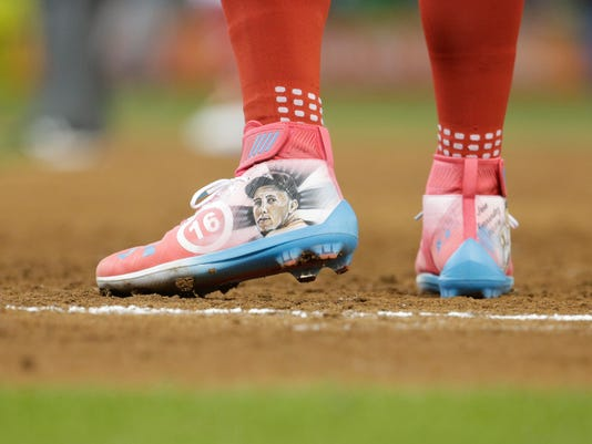 National League's Washington Nationals outfielder Bryce Harper (34), wears a pair of shoes honoring Miami Marlins pitcher Jose Fernandez, during the third inning at the MLB baseball All-Star Game, Tuesday, July 11, 2017, in Miami. (AP Photo/Lynne Sladky)