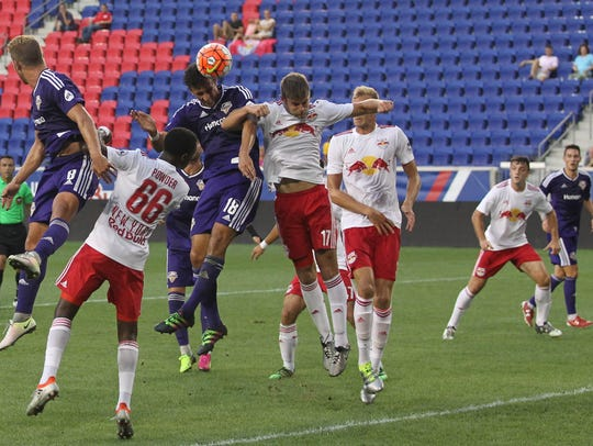 Louisville city FC's Paco Craig attempts to head the