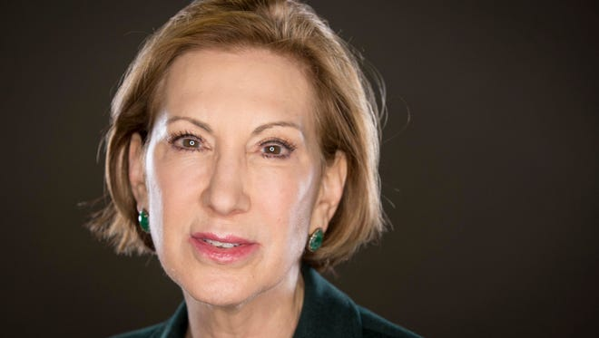 Republican presidential candidate Carly Fiorina poses in the studio for a photo after meeting with the Des Moines Register editorial board Wednesday Jan 13, 2016.