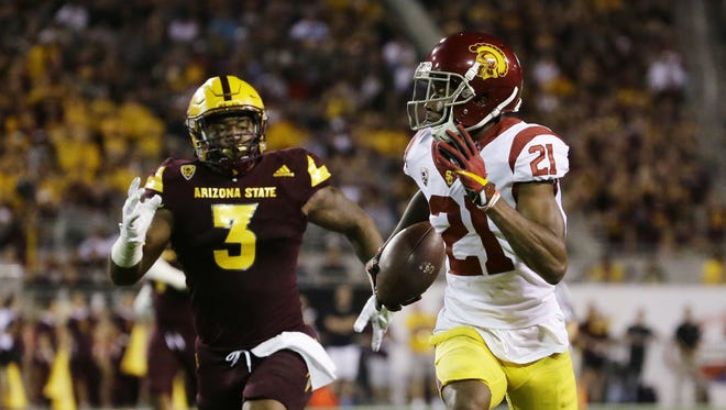 USC wide receiver Tyler Vaughns runs for a touchdown past Arizona State linebacker DJ Calhoun in the first half during PAC-12 action on Oct. 28, 2017 in Tempe, Ariz.