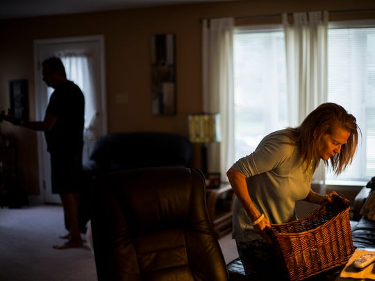 Lisa Kiick looks for a household item she can't find in the living room of their home on Sept. 27, 2015.