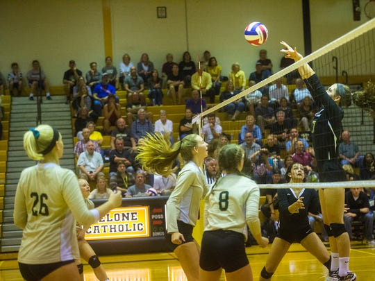 Delone Catholic's Claire Kaufmann sends the ball over the net during the game against York Catholic on Oct. 6, 2016.