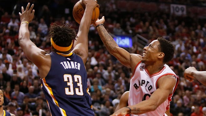 Pacers forward Myles Turner (33) defends against Toronto Raptors guard DeMar DeRozan (10) in game one of the first round of the 2016 NBA Playoffs.