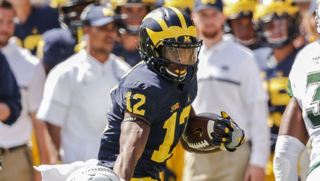 Michigan's Chris Evans makes a run against Hawaii during the home opener game at Michigan Stadium in Ann Arbor, Michigan, on Saturday, September 3, 2016.