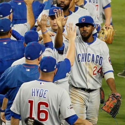 Chicago's Dexter Fowler, right, celebrates with teammates after the Cubs beat the Dodgers 8-4 in Game 5 of the National League Division Series at Dodger Stadium on Thursday in Los Angeles.