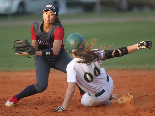 Lincoln's Cassidy Boltz slides in safely under the