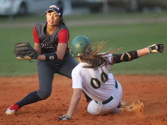 Lincoln's Cassidy Boltz slides in safely under the tag of Wakulla shortstop Willow Nixon.