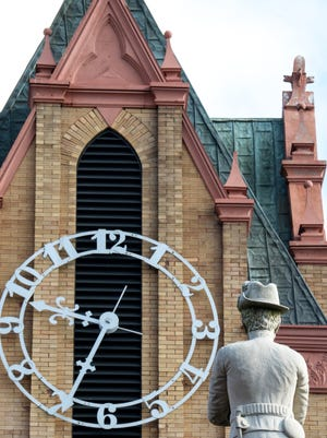 A confederate soldier statue faces the clock tower on the historic Anderson County Courthouse.