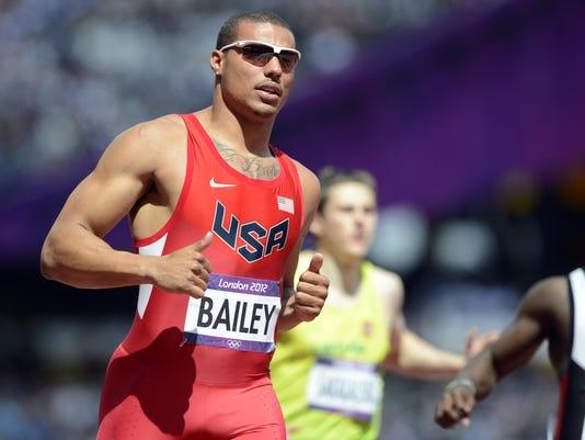 Olympics: Track and Field-Men's 100m-Heats