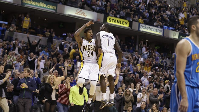 Indiana Pacers' Paul George (24) and Lance Stephenson celebrate during the second half of an NBA basketball game against the New Orleans Hornets Wednesday, Nov. 21, 2012, in Indianapolis.The Pacers defeated the Hornets 115-107 in overtime. (AP Photo/Darron Cummings)