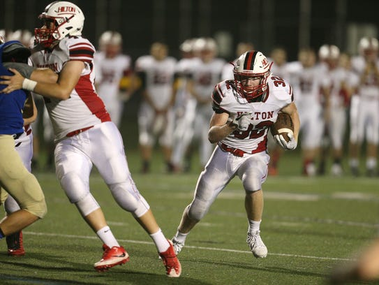 Hilton running back Max Chamberlain looks for a hole