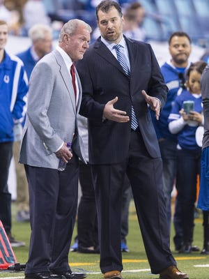Indianapolis Colts' owner Jim Irsay, left, talks with the team's general manager Ryan Grigson as the team warms up on the field before the start of an NFL football game Sunday, Nov. 29, 2015, at Lucas Oil Stadium.
