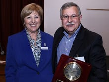Morris Habitat for Humanity Chief Executive Officer Blair Bravo and Gary Kastenbaum of Summit, after he received the Charles Lee Hamilton Award.
