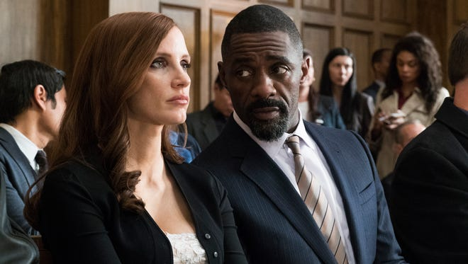 Molly Bloom (Jessica Chastain) gets some defense help from Charlie Jaffey (Idris Elba) in 'Molly's Game.'