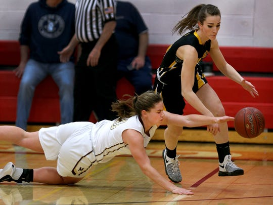Mendon's Sara Lyons dives to try and control a loose ball away from Honeoye Falls-Lima's Taryn Wilson in a Class A state qualifier game.