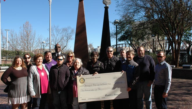 Members of the River Bend Rotary Club presented a check for $3,000 Friday to the Shreveport Police and Firefighters Memorial Fund to maintain and preserve the memorial site.