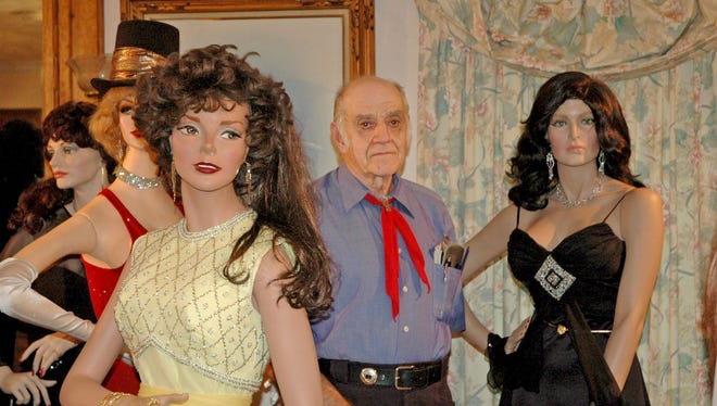 In this 2007 photo,  Mike Martin is photographed with his collection mannequins at his Beloit home. He created about 60 glamorous mannequins before his death this summer. They are now being auctioned online.