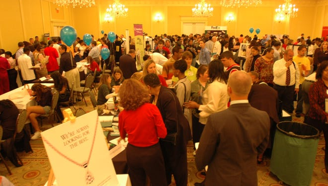 Job seekers talk to companies at a recent Easton Job Fair.