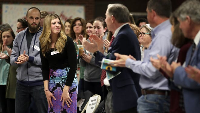 Erin Stoffel receives a standing ovation while being recognized Friday during the 2018 Heroes Ceremony at Neenah High School.